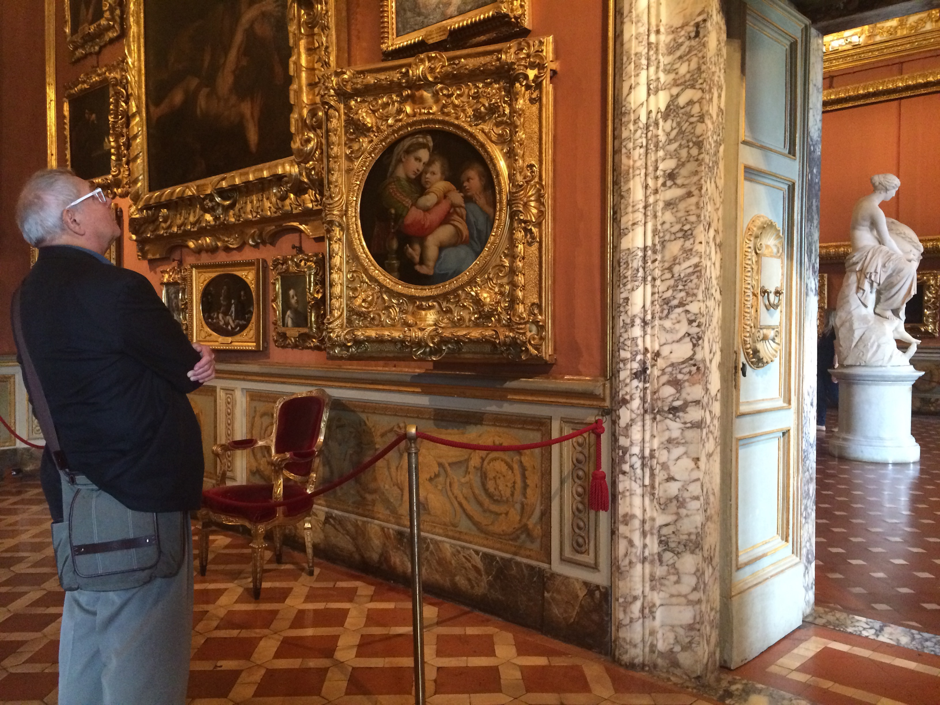 Earl in awe of Raphael's Madonna of the Chair in the Sala di Saturno gallery in Palazzo Pitti.