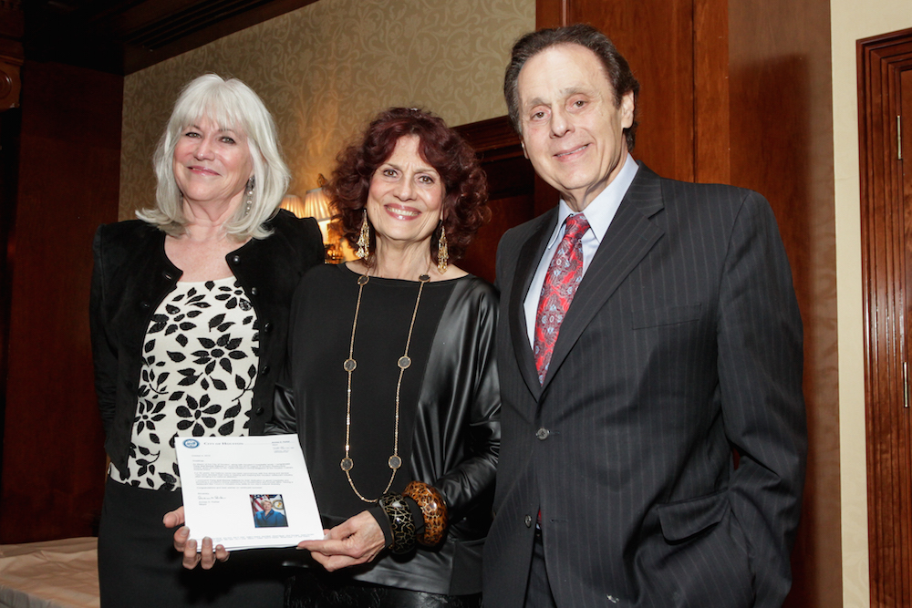 Donna and Tony Vallone were the 2015 recipients of the Legends award. Teresa Byrne-Dodge, far left, psoed with them at the 2015 awards dinner. (Photo by Kim Coffmann)