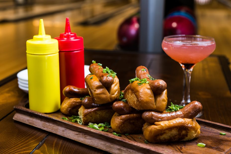 Bowl & Barrel's Dog Pile features six miniature hotdogs served with ketchup and mustard.