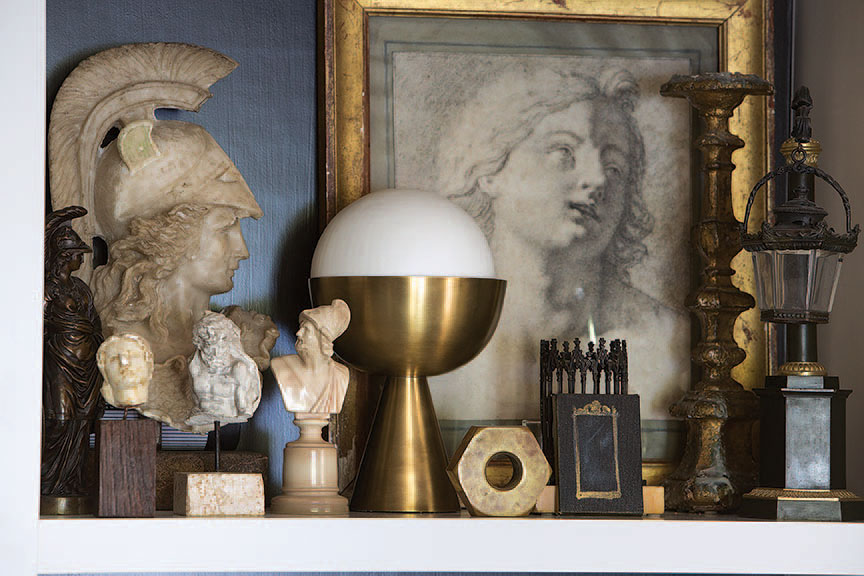 An 18th-century French drawing mixes with marble Grand Tour busts and an Art Deco lamp.