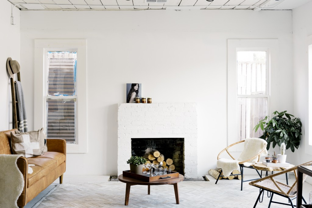 A fireplace is the center of the store's homey environment.