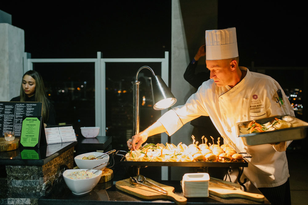 Chef Roger Benson unveils light bites for guests.