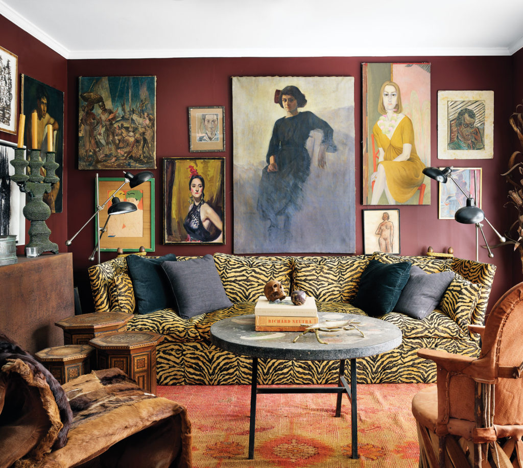 The first-floor sitting area's artworks are hung salon-style and include pieces by Wayman Elbridge Adams, Margaret Keane and Paul Jacoulet.