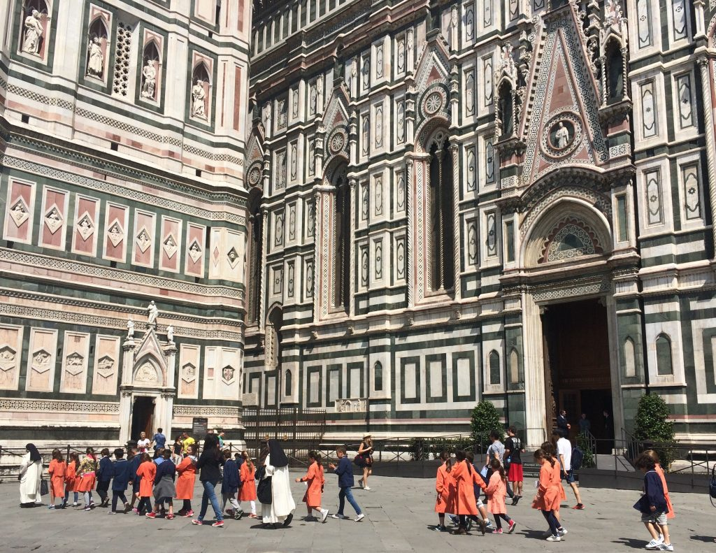 Field trip goers march past the Duomo in Florence.