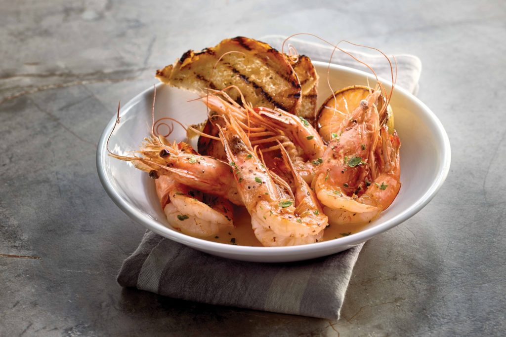 The Gamberi, which features colossal, head-on shrimp tossed in scampi gravy and served with soaking bread.