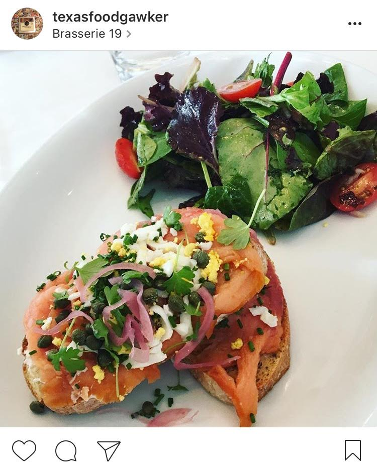 Smoked salmon tartine with pickled red onion, capers, chopped egg, goat cheese and a side salad from Brasserie 19