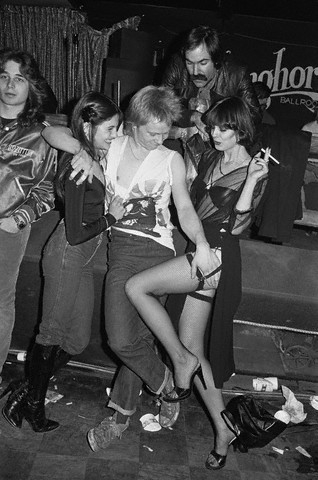 Paul Cook of The Sex Pistols misbehaves in 1978 at the Longhorn. (Photo © Lynn Goldsmith/Corbis)