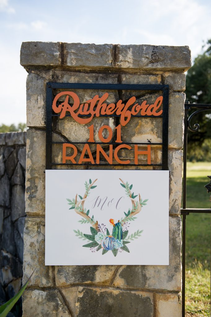 The setting, decked out with wedding flourishes: Rutherford Ranch, established 1948, Buda, Texas.