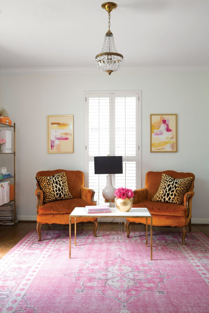 Knapp opted not to reupholster vintage orange chairs that belonged to her grandparents, given that orange is House of Harper's signature color.