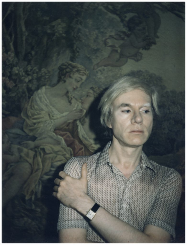 Andy Warhol wearing his Tank watch in a self portrait.