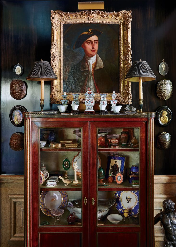 Collector's cabinet from A La Vielle Russie in New York City holds Russian objects and Chinese porcelains.