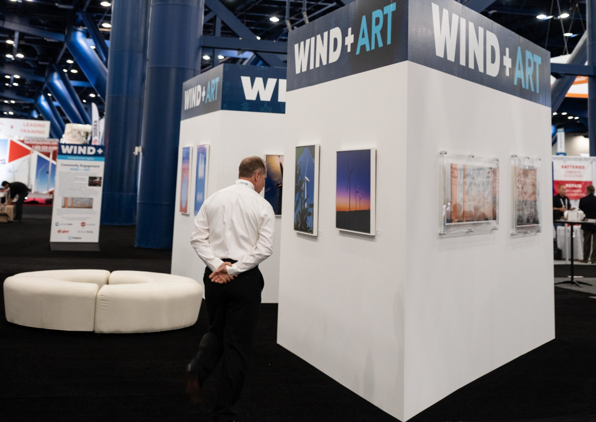 A visitor checks out Foto Relevance's booth at the Windpower Conference. The convention underwrote the Houston gallery's booth in order to showcase artists responding to wind energy. (Photo by Priscilla Dickson)